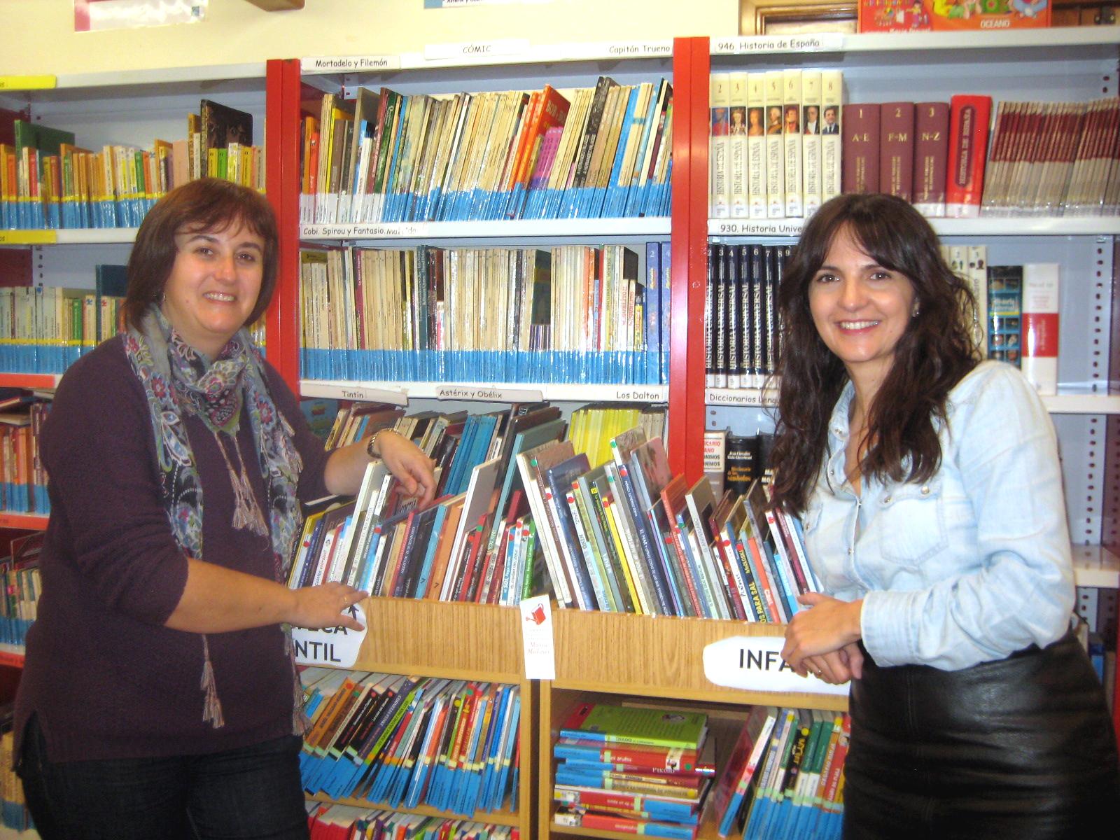 Marisa y Nines, bibliotecarias de Yunquera